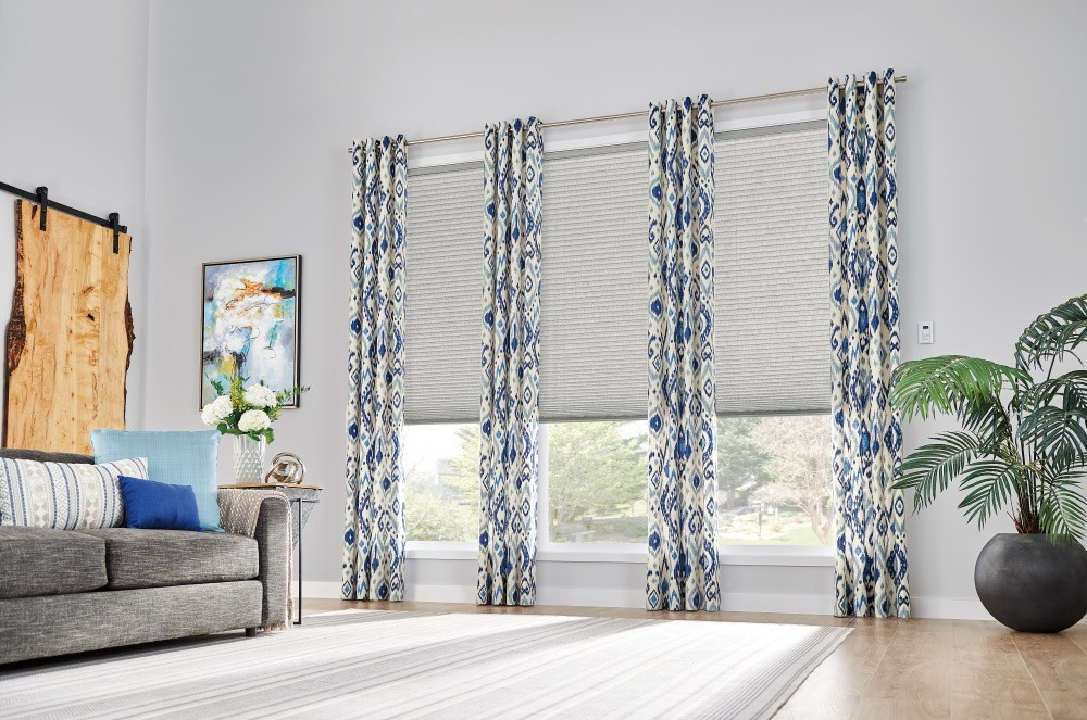 "Windows: 3/4"" Single Cell Cellular Shades with Motorized Lift: Couture, Noble Pewter 0133Drapery: Decorative Panels with Grommet Top: Kearney, Lakeshore 5760Hardware: 1"" Finesse Pole in Brushed Nickel, 442"