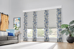 """Windows: 3/4"""" Single Cell Cellular Shades with Motorized Lift: Couture, Noble Pewter 0133 and 7 1/2"""" Noble Cornice with Keystone: Snowflake 1603Drapery: Decorative Panels with Grommet Top: Kearney, Lakeshore 5760"""