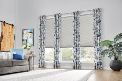 """Windows: 3/4"""" Single Cell Cellular Shades with Motorized Lift: Couture, Noble Pewter 0133Drapery: Decorative Panels with Grommet Top: Kearney, Lakeshore 5760Hardware: 1"""" Finesse Pole in Brushed Nickel, 442"""